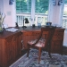dark-wood-desk-in-front-of-window
